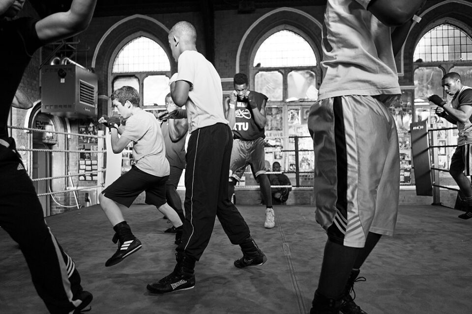 """Various age boxers training in the ring on the technique called """"Shadow boxing"""". They all need to share the ring and not to hit each other. They need to create fictional fight."""